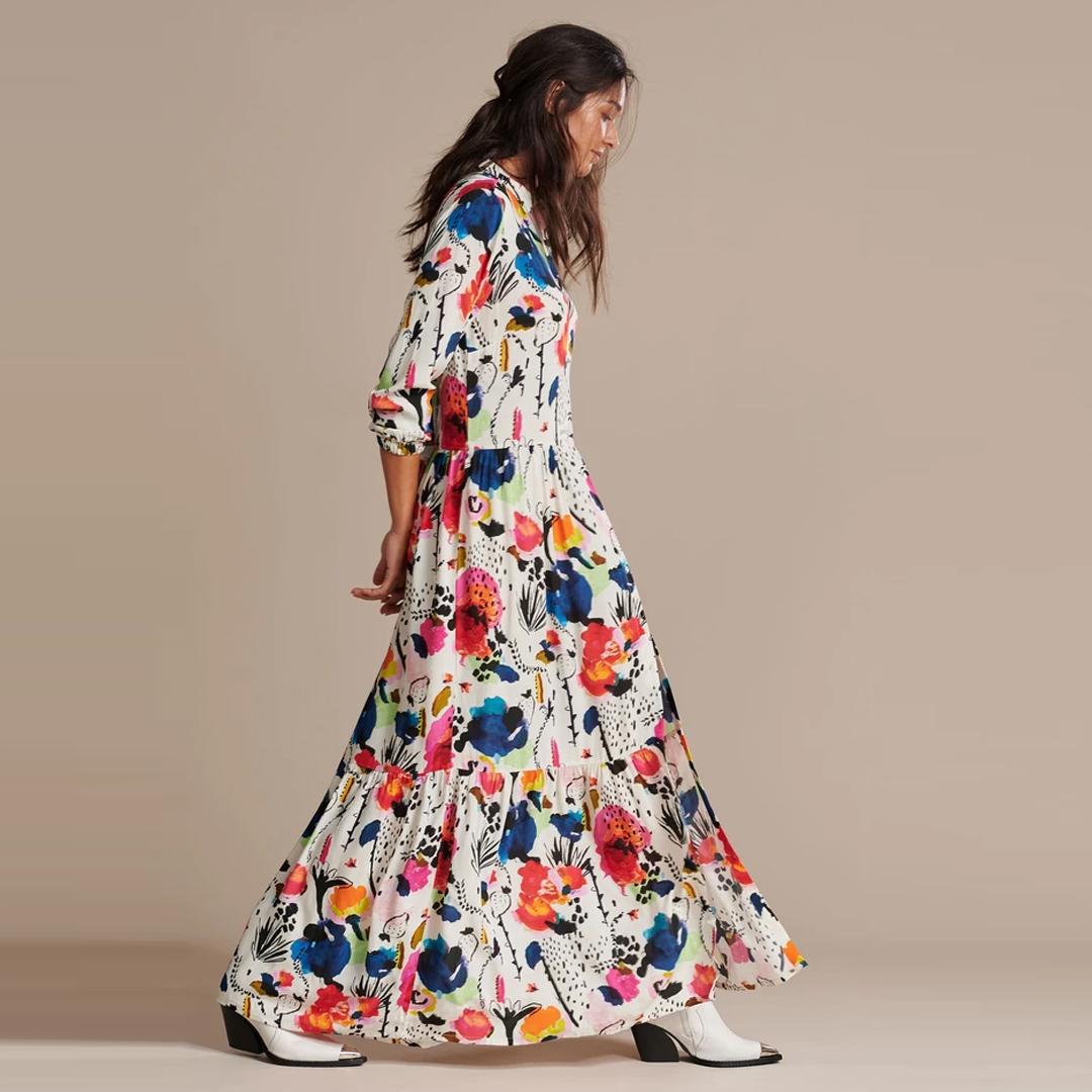 Vestido longo camisero con volantes baixo manga longa flores