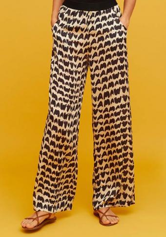 Pantalón goma cintura con petos laterais